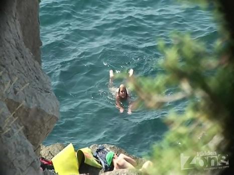 Hidden-Zone.com- Nu1217# We continue to see a young girl on a nudist beach. She decided to jump off a cliff into th