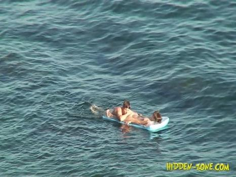 Hidden-Zone.com- Nu1226# A young couple is floating on air mattress. Both completely naked_the man rubbed his head