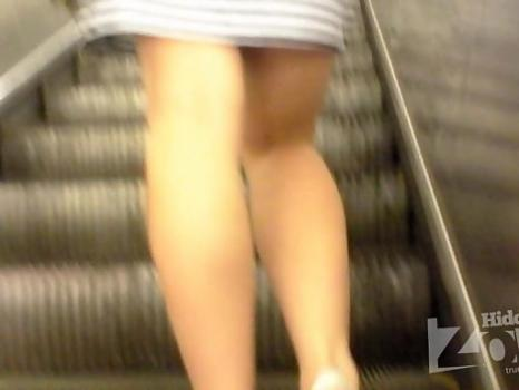 Hidden-Zone.com- Up1970# Girl in a short striped skirt. Excellent shots shaved crotch in white panties. The girl di