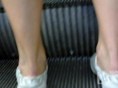 Hidden-Zone.com- Up1986# Tanned girl in a short white dress. Our cameraman shot with a hidden camera her hairy crot