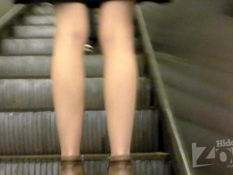 Hidden-Zone.com- Up2119# Slim blonde in a short brown skirt. Smart ass and white panties and pantyhose closeup. Ano