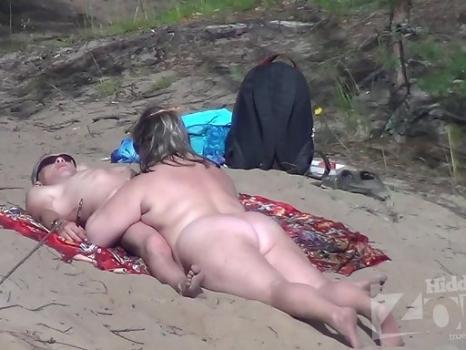 Hidden-Zone.com- Nu1675# The woman starts to suck a man_s penis. This is not often seen even on a nudist beach! How