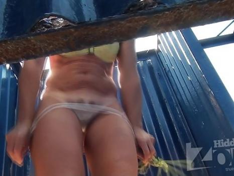 Hidden-Zone.com- Bc1913# Tanned woman dresses swimsuit. Beautiful tanned body and a haircut on pussy closeup. A goo