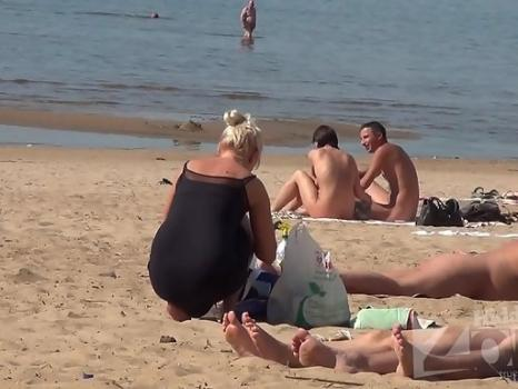 Hidden-Zone.com- Nu1715# The blonde in a black dress came to the beach. She arranges a place for a long time and fi