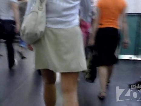 Hidden-Zone.com- Up2391# Tanned brunette in a short gray skirt. Our cameraman filmed on hidden camera her gorgeous ro